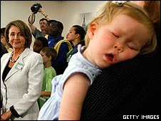 Baby sleeping near Nancy Pelosi