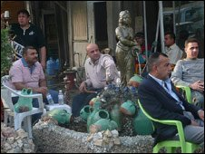 Iraqis sitting at Laith's Cafe in Baghdad