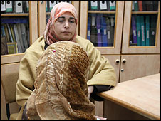 Eman, victim of domestic violence (back view), Gaza