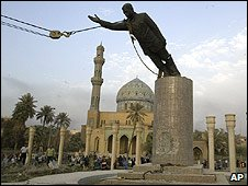 Statue of Saddam Hussein being toppled in 2003