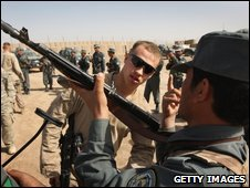 A US marine trains Afghan national police on weapons safety on March 25, 2009 in Bakwa