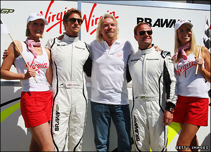 Richard Branson poses with both Brawn drivers