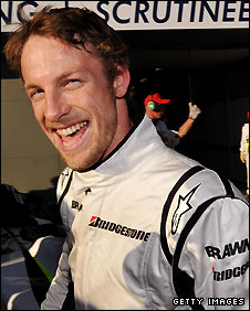 A jubilant Jenson Button celebrates getting pole position in Melbourne