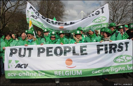 Green Party supporters with Put People First banner