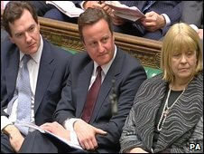 David Cameron sitting between George Osborne and Cheryl Gillan
