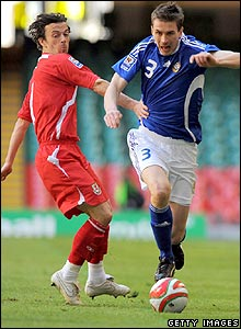 Wales's Simon Davies hauls back Toni Kallio