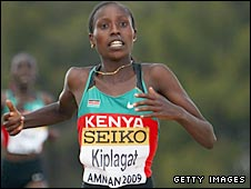 Florence Kiplagat crosses the line to win on Saturday