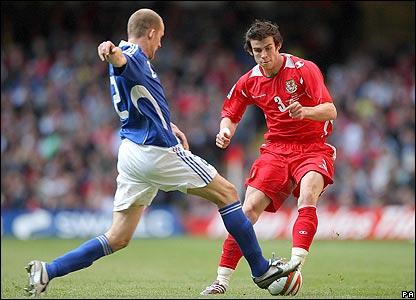 Finland's Petri Pasanen tackles Gareth Bale