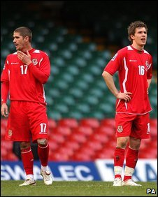 Carl Robinson and Aaron Ramsey are left dejected after Wales' defeat