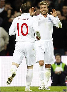 David Beckham and Wayne Rooney celebrate