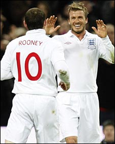 Beckham (right) set up Wayne Rooney for England's second goal