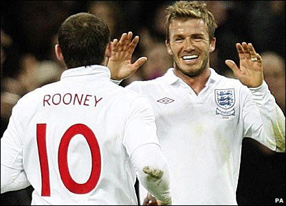 Beckham (right) set up Wayne Rooney for England's second goal against Slovakia