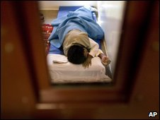 An unnamed inmate sleeps in his cell at Guantanamo, file image