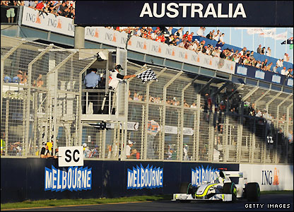 Jenson Button crosses the line at the Albert Park