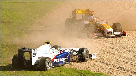 Nick Heidfeld in the BMW and Fernando Alonso's Renault end up on the gravel