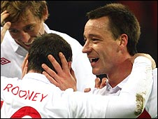 Wayne Rooney (left) is congratulated by John Terry after scoring against Slovakia