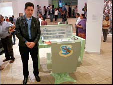 Artist Doug Young with sculpture of nuclear command desk