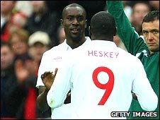 Cole (left) and Heskey are both out of England's game against Ukraine