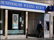 Man walking past a Dunfermline branch