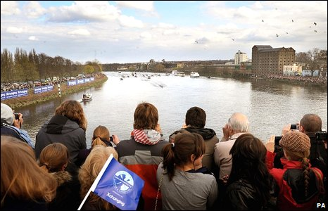 Crowds on Chiswick Bridge watch Oxford's final strokes