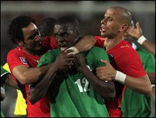 Egyptian and Zambian players grapple during their match in Cairo