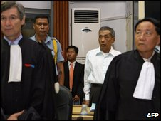 Duch ( in the white shirt) with defence lawyers at the trial (30/03/09)