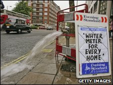 Evening Standard billboard next to burtst pipe from May 2006