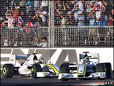 Jenson Button and Rubens Barrichello wave to the crowd after their one-two victory in Australia