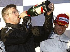Team boss Ross Brawn and Jenson Button celebrate on the podium after winning the Australian Grand Prix