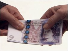 Twenty pound notes being handed over