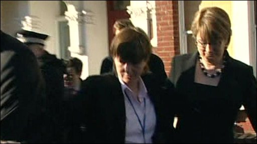 Jacqui Smith is escorted from home