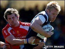 Worcester's Alex Grove is unable to hold on to Bristol's Lee Robinson