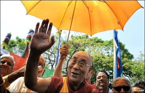 The Dalai Lama waves as he arrives at the Tibetan Arts and Culture exhibition in New Delhi, India, 30 March 2009