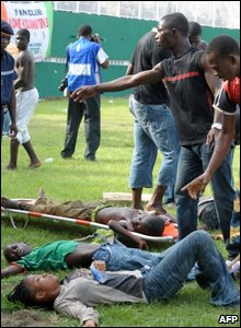 Injured are collected at Felix Houphouet-Boigny stadium in Abidjan on 29 March 2009