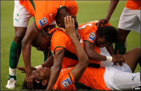 Didier Drogba (bottom) after scoring at Felix Houphouet-Boigny stadium in Abidjan on 29 March 2009