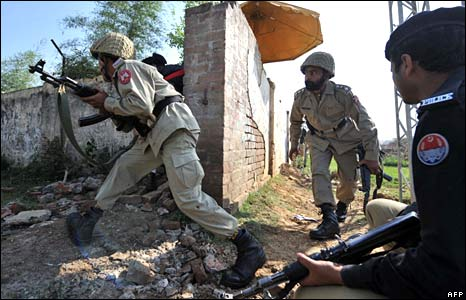 Pakistani paramilitary soldiers make their way into the academy