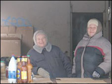 Women selling food and drinks in Pikalevo