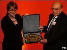 Home secretary Jacqui Smith presents Dr Ikram Malik with the Al Biruni award