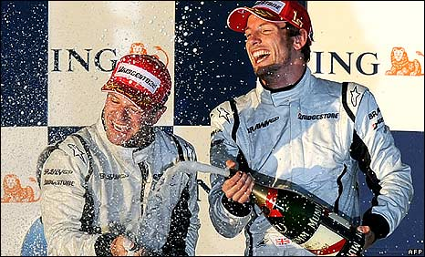 Rubens Barrichello and Jenson Button celebrate after the Australian Grand Prix