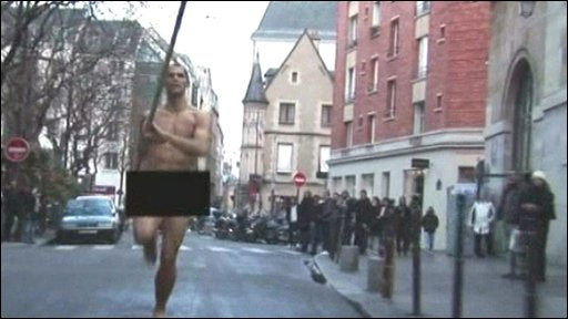 Pole vaulter Romain Mesnil runs naked through the streets of Paris