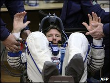 Gennady Padalka is prepared before boarding a spacecraft in Kazakhstan, 26 March 2009