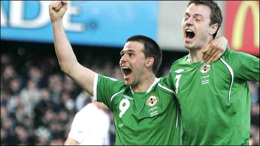 Jonny Evans (right) celebrates his goal with David Healy