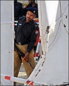A Pakistani soldier inspects the damage to the attacked Manawan police academy