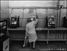 Elderly woman plays the fruit machines on Brighton Pier, 1978