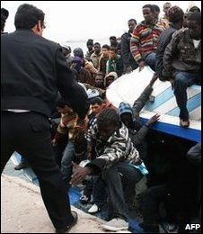 Libyan migrants rescued from stormy sea crossing.