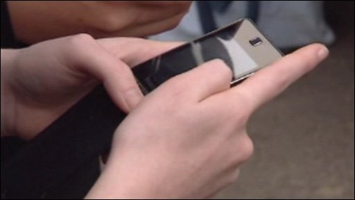 Teenage girl holds a mobile phone