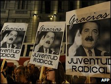 Supporters of Raul Alfonsin mourn his death
