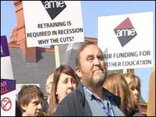 Protesters waving placards opposing cutbacks in further education, on April 1