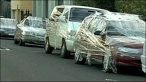 Cars covered in clingfilm in Australia