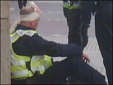 An injured officer near Liverpool Street (sent in by Natalie Barone)